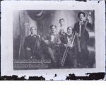 Group portrait of five men with instruments