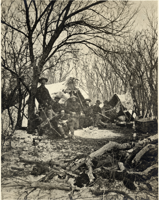 Camp scene under trees with unidentified men