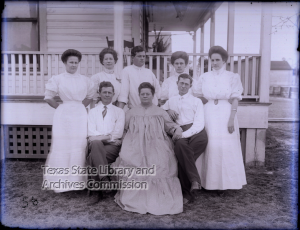 Group portrait in front of porch