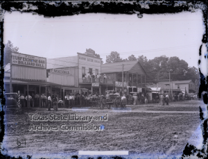 Street scene in Batson, Texas, includes the Crosby House, Spencer Drug Co., and the Turf Exchange Bar and Billiard Hall