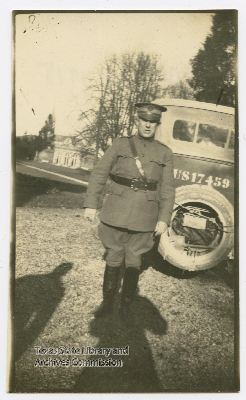 Hulen in uniform standing in front of car, Marne, France