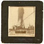 A matted photograph of the Batson Oil Gusher